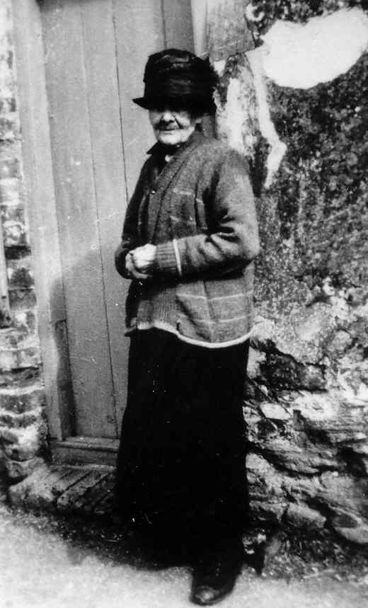 Mary Yarrow (née Gothard) outside her home in Little Thetford