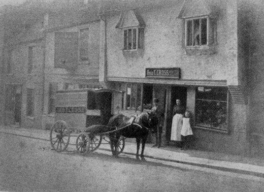 Frederick Thompson Cross with wife Elizabeth, and daughter Daisy, outside their shop at Forehill, Ely, in 1892