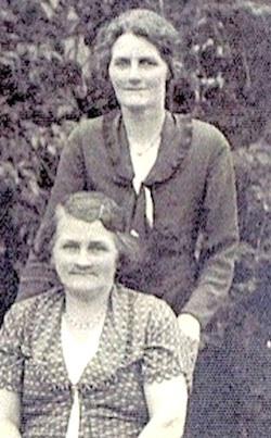 Laura Yarrow (née Dewsbury) standing with sister Ellen in 1925.