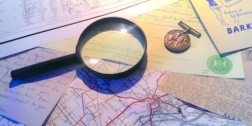 Magnifying glass and old documents