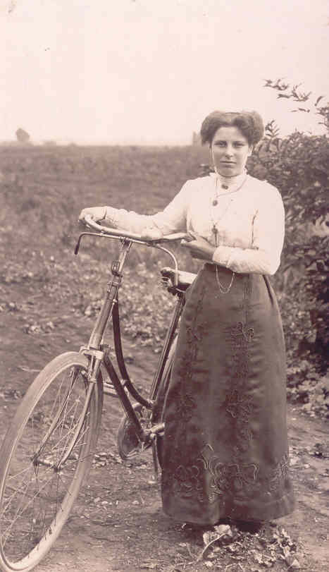 Ethel May Martin with her bicycle in Downham Fen