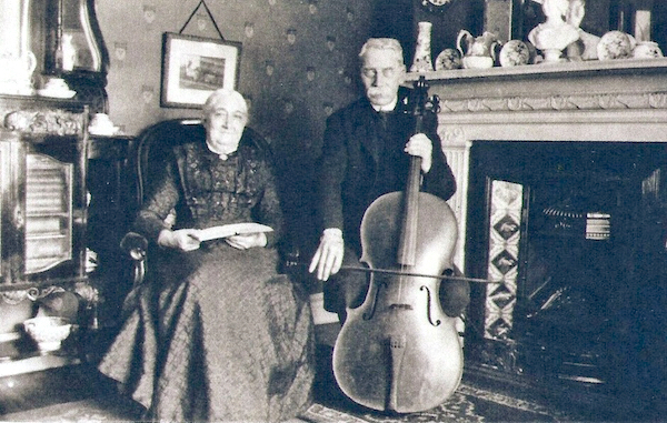 William Yarrow playing cello alongside his wife Emma, at home in Liverpool. Photo: Andrew Martin.
